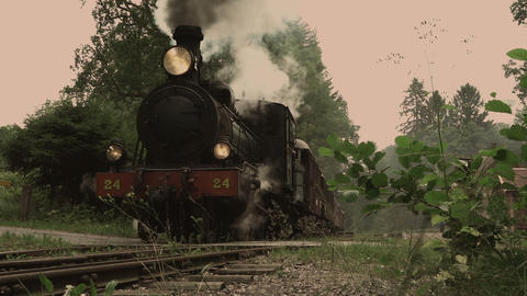 Vintage steam locomotive passing by Footage