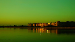 Urban landscape with lake at sunset and golden reflections Footage
