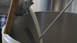 Milkman Pouring milk in milk cooler tank Footage