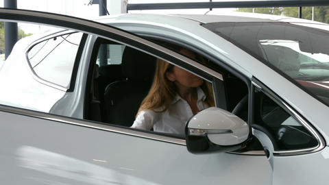 Businesswoman checking out a car Live Action