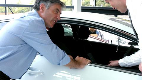 Businessman explaining the car details Footage
