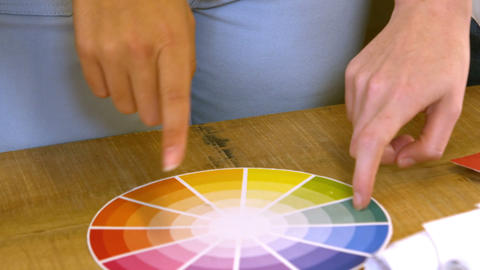 Creative team choosing colours from a colour wheel Live Action