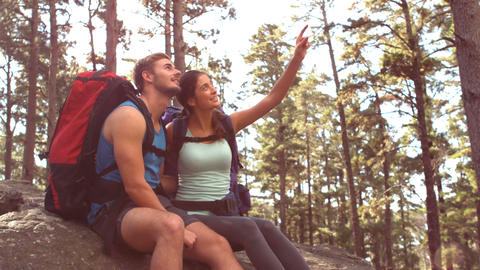 Couple resting after hiking and pointing Footage