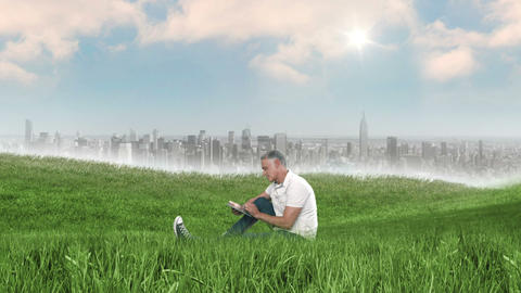 Casual man using tablet in field Animation