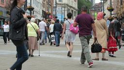 People walking along Briggate, Leeds Footage