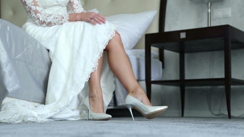 Beautiful legs of the bride in white shoes ビデオ