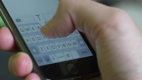 Male hand typing a text on Iphone 6 Footage