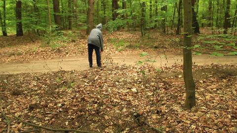 Hooded axeman dragging along an axe ビデオ