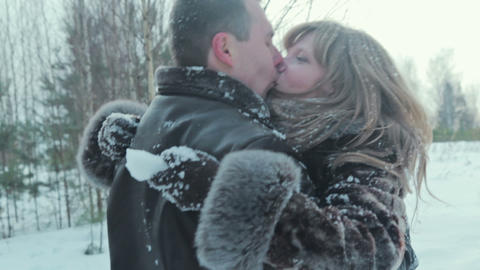 Couple have fun and kissing in winter forest Footage