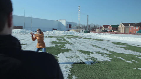 Couple playing and running on the football football field Footage