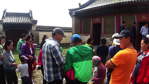 tourists listening to the guide in the ancient Mongolian monastery complex Footage