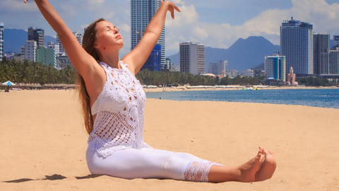 blonde girl in lace shows yoga asana head-to-knee from twist Footage