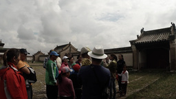 Tourists listen to a lecture guide from the walls of the old Mongolian Buddhist  Footage
