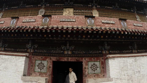 People crowded in the doorway of an old Buddhist temples of the ancient monaster Footage