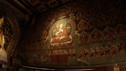 a great religious figure on the wall in an ancient Buddhist temple inside Archivo