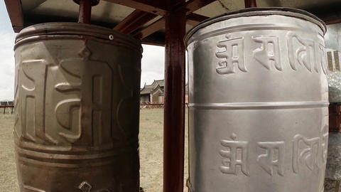 two reels of old prayer mantras inscribed in Sanskrit close up Footage