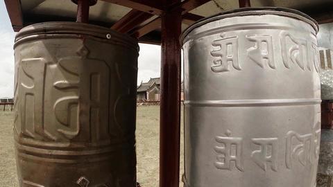 two reels of old prayer mantras inscribed in Sanskrit close up Footage