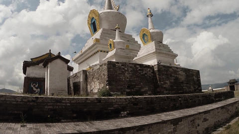 white sacred Buddhist temple in old building against the blue sky Footage