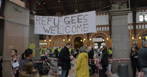 Banner Refugees Welcome Hanged by Charity Collecting Point in Copenhagen Railroa Live Action