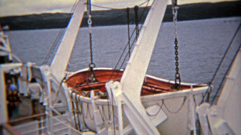 SEATTLE, WASHINGTON 1974: Lifeboats at sunset on a cruise ship sailing across th Footage