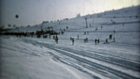 MONTREAL, CANADA 1975: Drive up ski resort right next to road, parking on slopes Footage