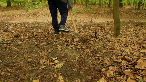 Medium shot of an axe dragging along the ground ビデオ