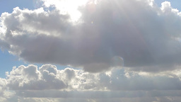 Clouds passing by with sunrays, fast moving, time lapse Footage