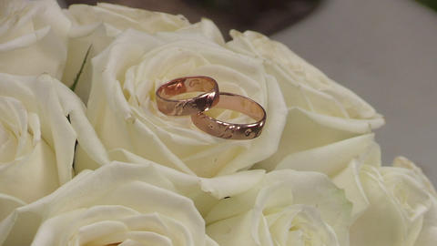 Wedding Gold Rings On The Roses Flowers Footage