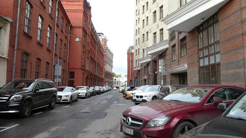 Street with old cars and the high walls of buildings Yakimanka September 2015, M Footage