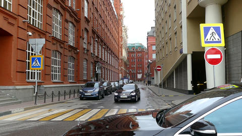 Street with old cars and the high walls of buildings Yakimanka September 2015 Live Action