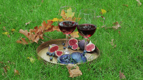 autumnal still life with red wine and berry Live Action