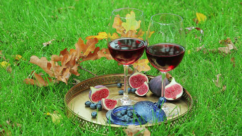 autumnal still life with red wine and berry Footage