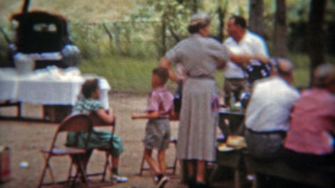 BALTIMORE, MARYLAND 1975: Sunday summer community town picnic potluck lunch Footage