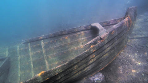 Nose of a sunken rowboat with sunbeams Footage