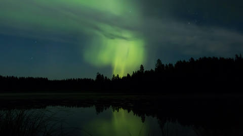Summertime aurora borealis over a lake time-lapse Footage