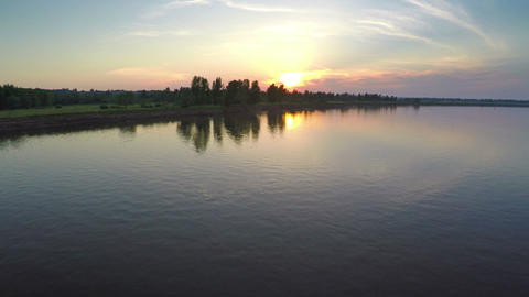flying over river at sunset Footage