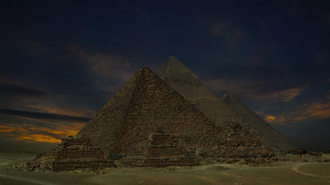 sunset clouds over pyramids at Giza, Egypt Footage