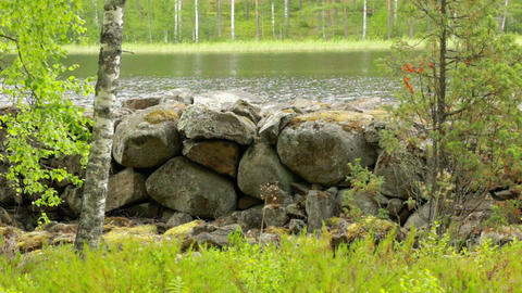 Salpa line stone barrier by a river in Finland Live Action