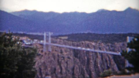 COLORADO 1955: Royal Gorge Colorado entrance and car travel across bridge Footage