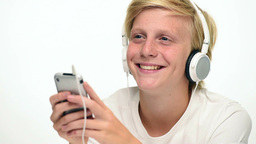 Rack Focus From Smartphone To Teenager Face With Headphones stock footage