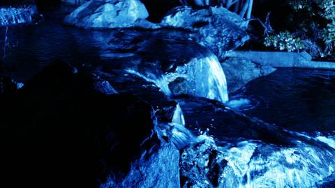 illuminated water falls at night with rocks Footage