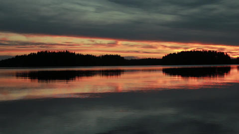 Beautiful late evening sunset at lake in Finland Live Action