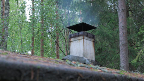Smoke rising from a smokestack of an old wooden sauna Footage