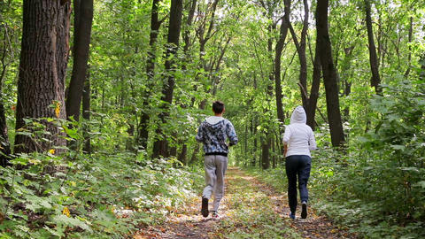 Man And Woman Running In Park 1 stock footage