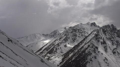 Snowy Peaks in the Clouds HD Footage