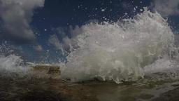 Slow motion, waves splashing over a rock towards camera Footage