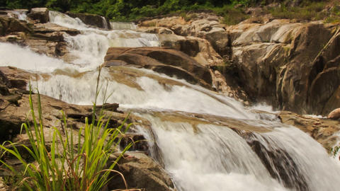 closeup view of waterfall among rocks in tropical park Footage