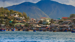 closeup small village on island with fishing boats Footage