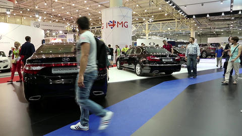 Black Hyundai Grandeur and Hyundai Genesis at automotive-show Footage