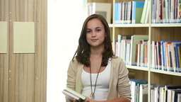 Smiling Teenager Student Girl In School Library stock footage
